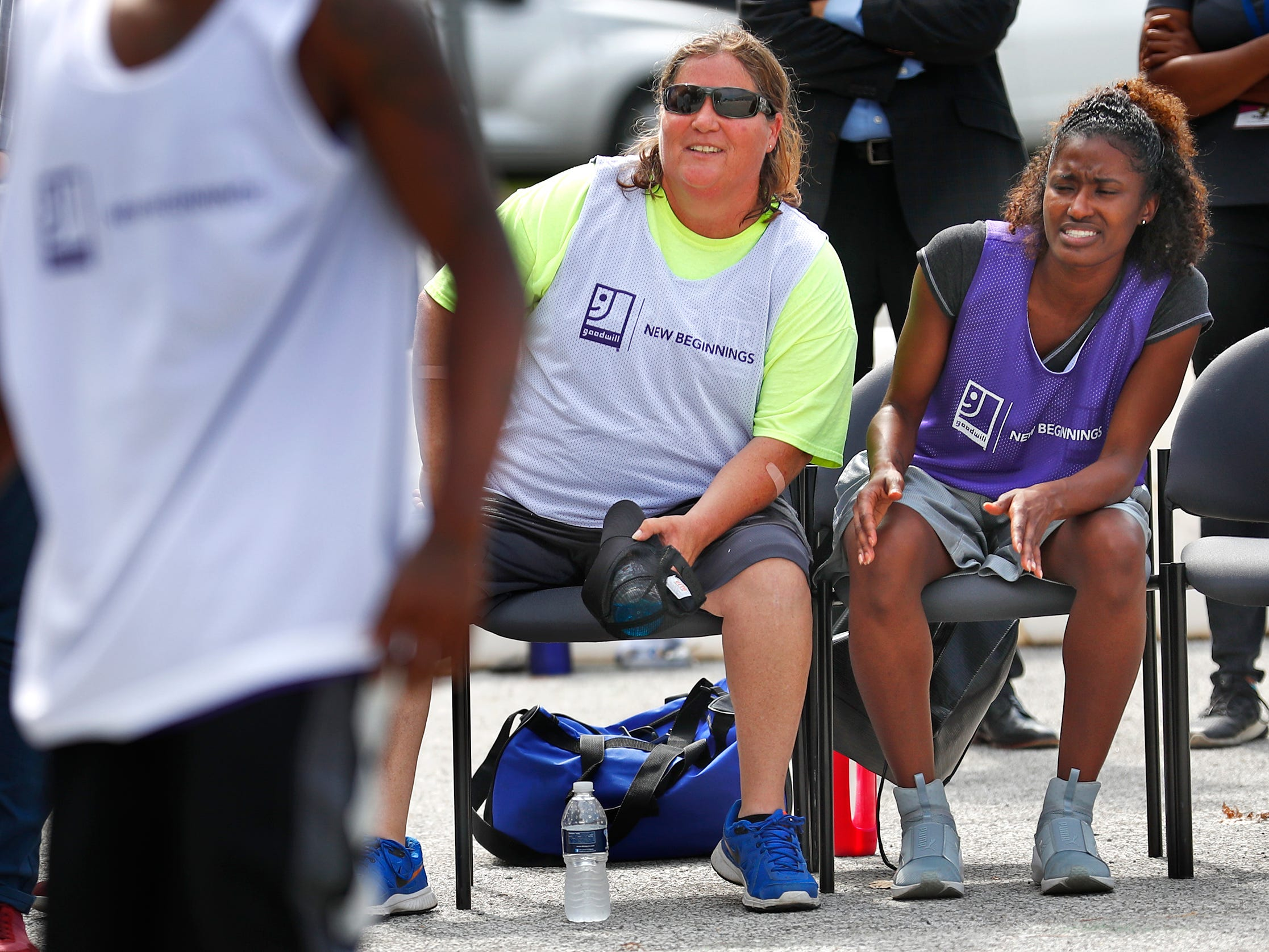 Tonya Surber, left, and Alexaundria Monroe, both with Marion County Probations, watch a game during a basketball game at Goodwill Commercial Services, Wednesday, Sept. 19, 2018.  Goodwill Industries of Central Indiana's New Beginnings hosted the 3-on-3 basketball tournament bringing together participants in New Beginnings, a six-month re-entry program for ex-offenders that works on job and life skills, with representatives from Goodwill, IMPD, the Mayor's office, Marion County Probation department and other services.  The goal is to celebrate the New Beginnings program while breaking down re-entry barriers through basketball.