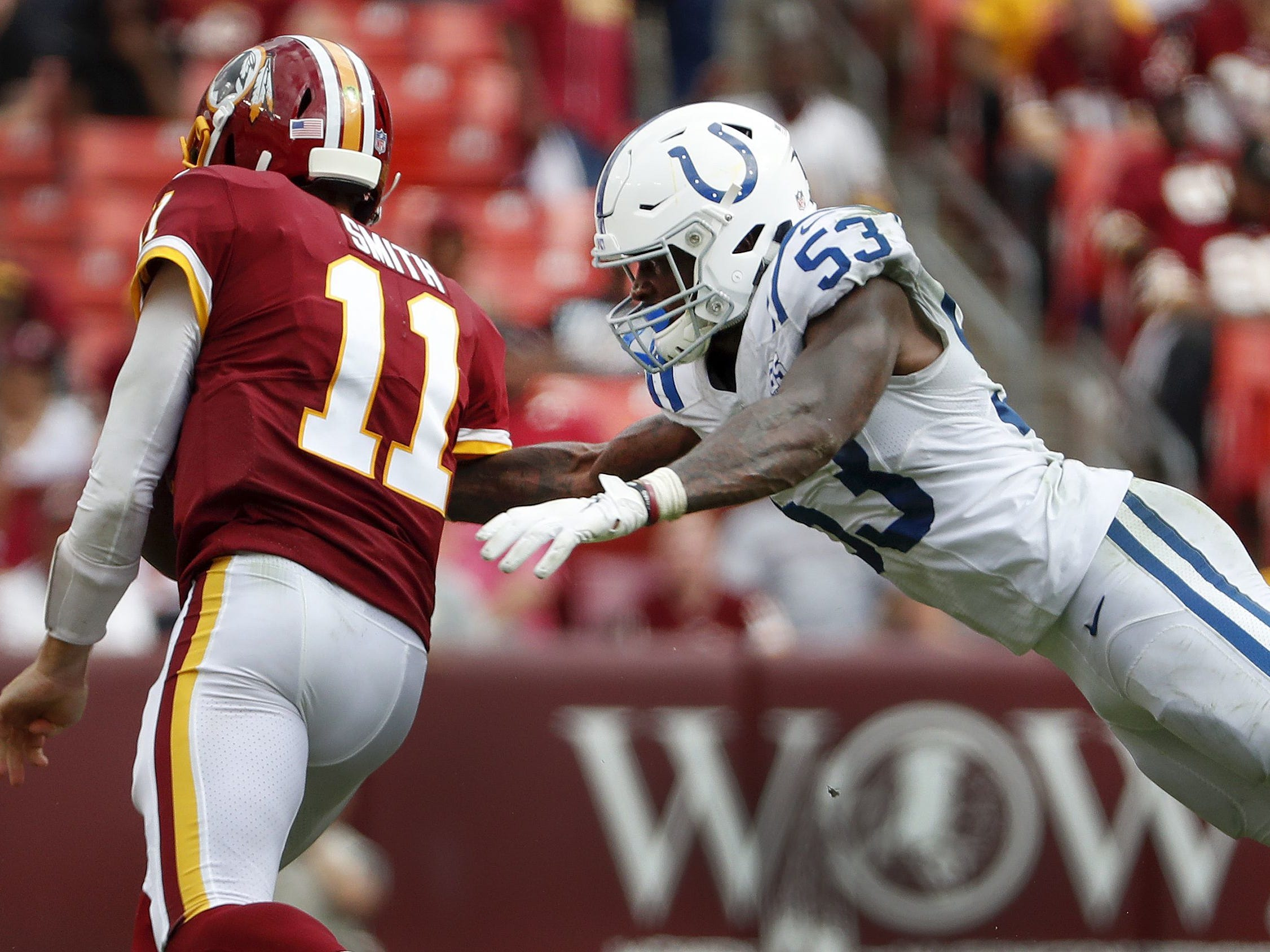 Colts linebacker Darius Leonard dives at Redskins quarterback Alex Smith in the second half of their Sept. 16, 2018 game.
