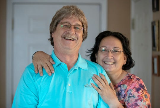 Eric Passmore and his partner of 10 years, Paula Koneda, at their home in Franklin on Monday, Sept. 17, 2018. Passmore is among the 1 in 1,000 men diagnosed with breast cancer. He and Koneda will model in the Pink Ribbon Connection Fashion Show on Oct. 13.