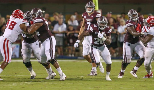 Mississippi State's Elgton Jenkins (left) blocks for Aeris Williams (26) against Louisiana on Saturday, September 15, 2018, in Starkville. Photo by Keith Warren/Madatory Photo Credit