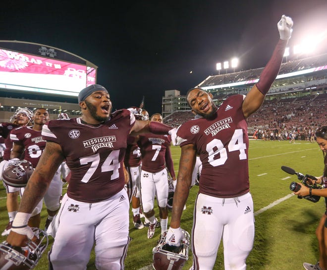 Senior center Elgton Jenkins (74) celebrates with sophomore tight end Dontea Jones (84) after Mississippi State's win over Louisiana on Saturday, September 15, 2018, in Starkville. Photo by Keith Warren/Madatory Photo Credit