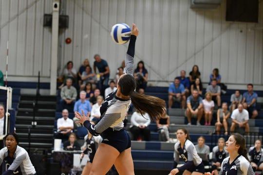 Jackson Academy sophomore Parker Bracken spikes a ball during a game her freshman season.