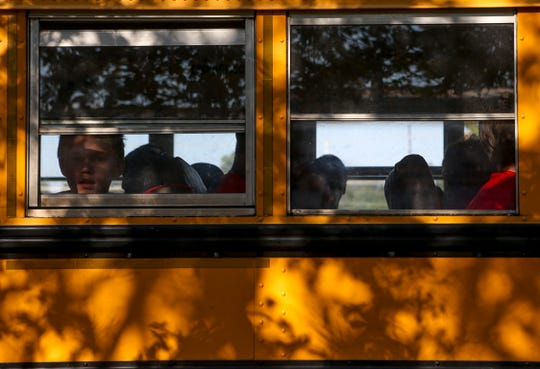 A young boy looks out the window upon arriving at the Day of Champions celebration held at Jackson Fairgrounds Park in Jackson, Tenn., on Wednesday, Sept. 19, 2018.