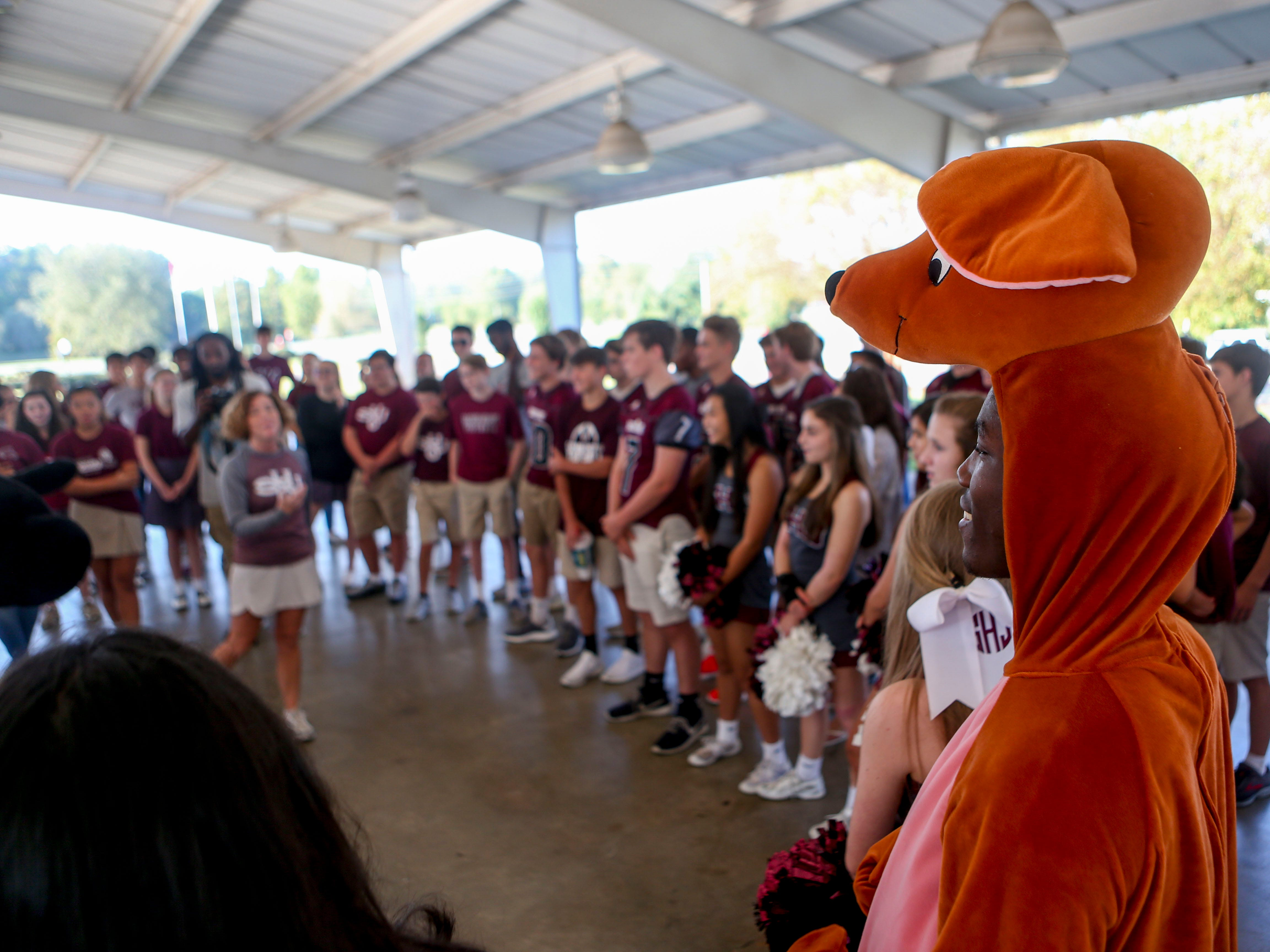 Roo from Winnie the Pooh stands in a circle before an opening prayer at the Day of Champions celebration held at Jackson Fairgrounds Park in Jackson, Tenn., on Wednesday, Sept. 19, 2018.