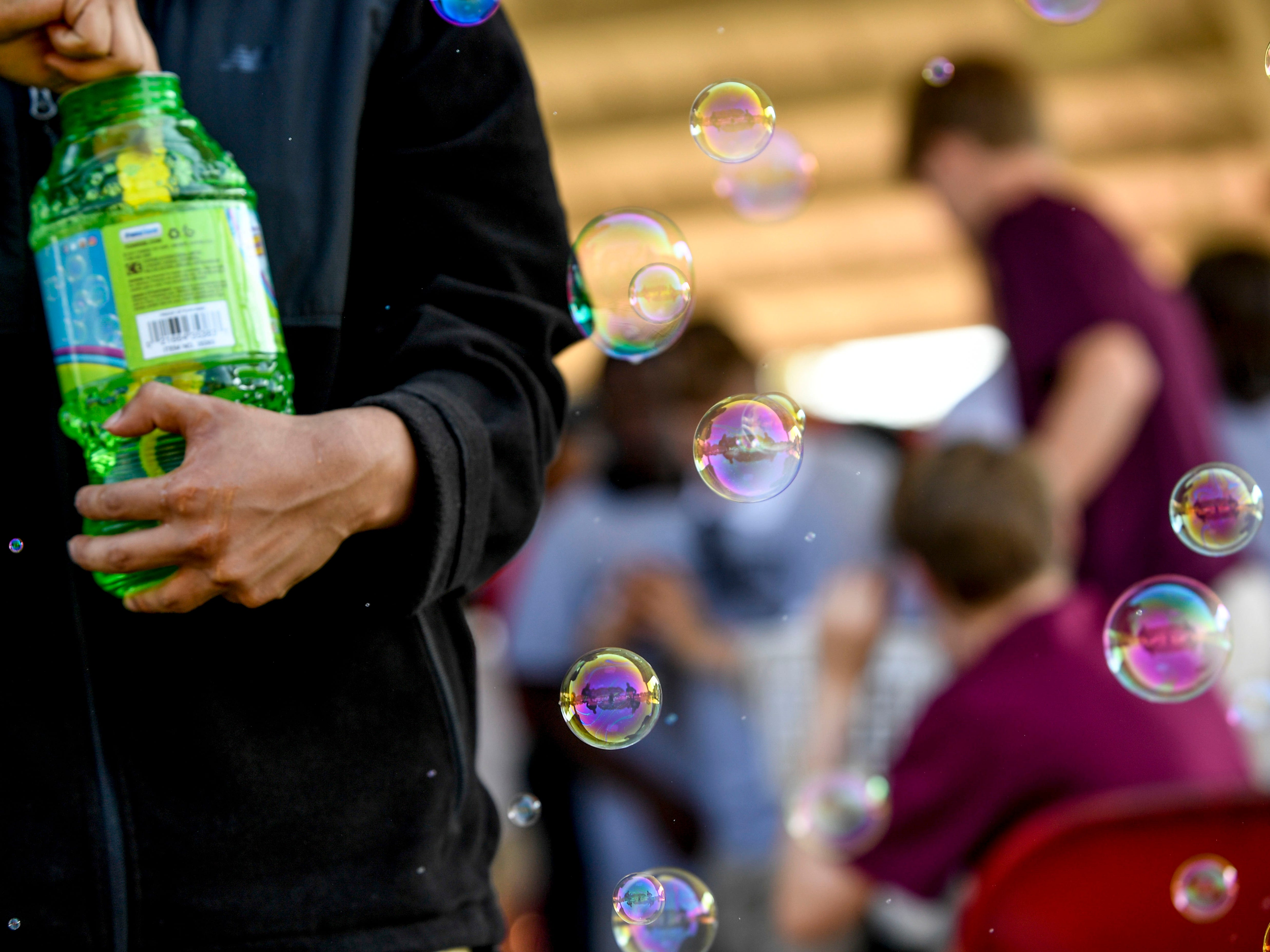 Bubbles float in the air at the Day of Champions celebration held at Jackson Fairgrounds Park in Jackson, Tenn., on Wednesday, Sept. 19, 2018.