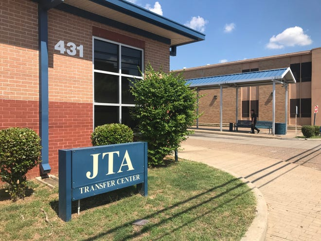 A man walks to the bus stop at the Jackson Transit Authority Transfer Center in downtown Jackson.