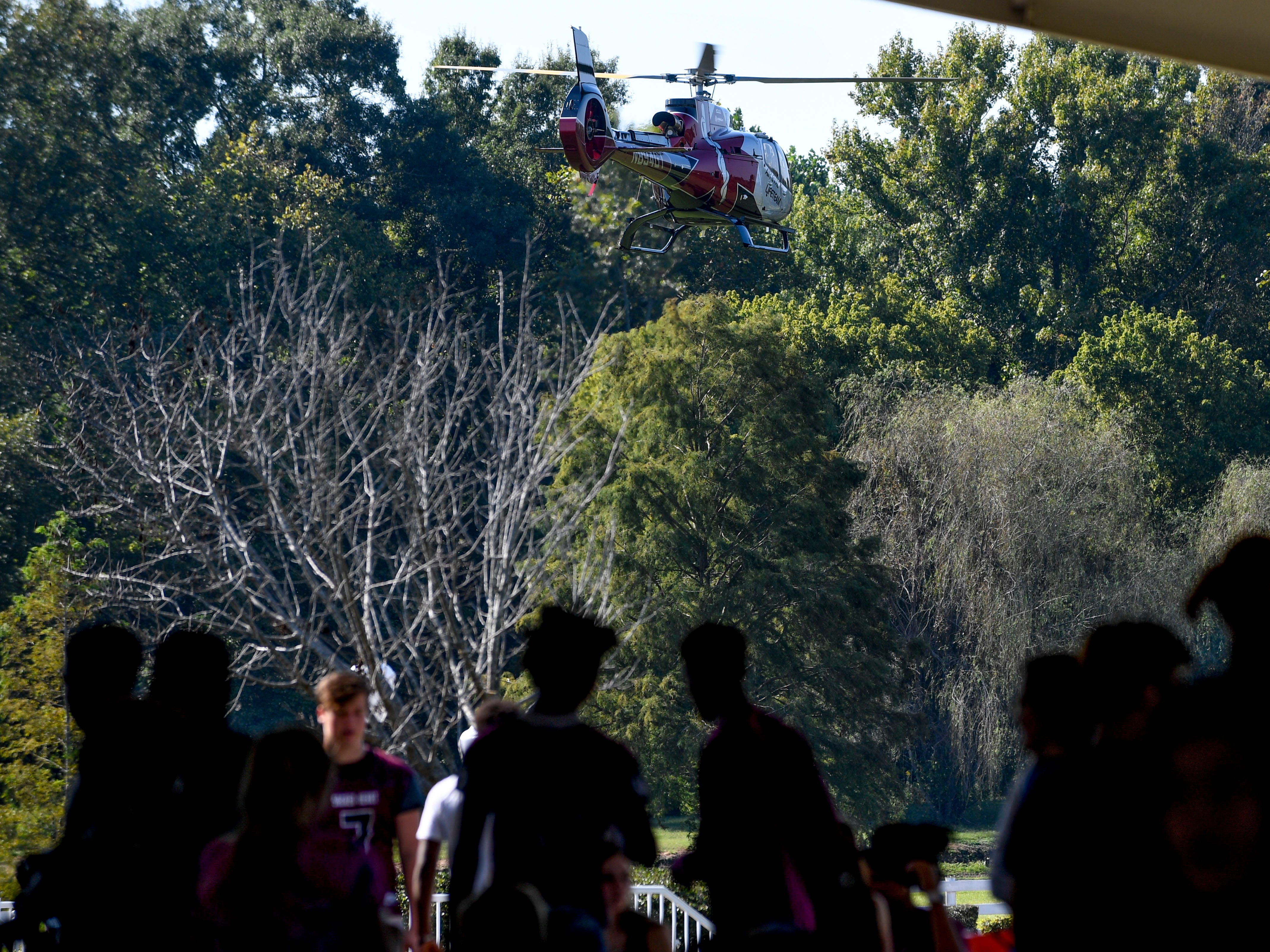 A medical evacuation helicopter departs from the Day of Champions celebration held at Jackson Fairgrounds Park in Jackson, Tenn., on Wednesday, Sept. 19, 2018.
