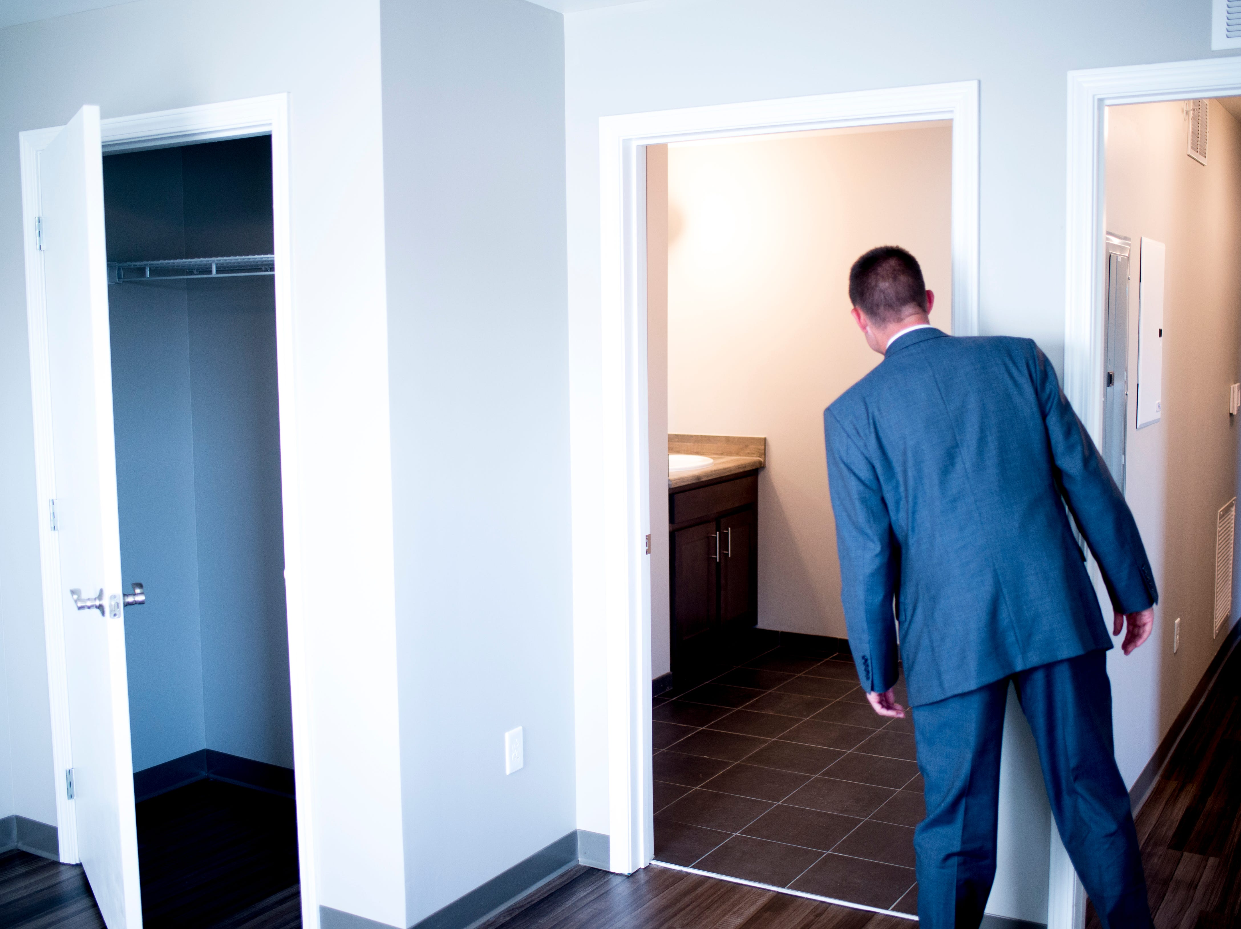 An attendee takes a peek inside one of the Five Points Phase 2 affordable housing complex apartments in Knoxville, Tennessee on Wednesday, September 19, 2018. The 10-building, 84-unit affordable housing complex has been part of Mayor Rogero's focus on affordable housing.