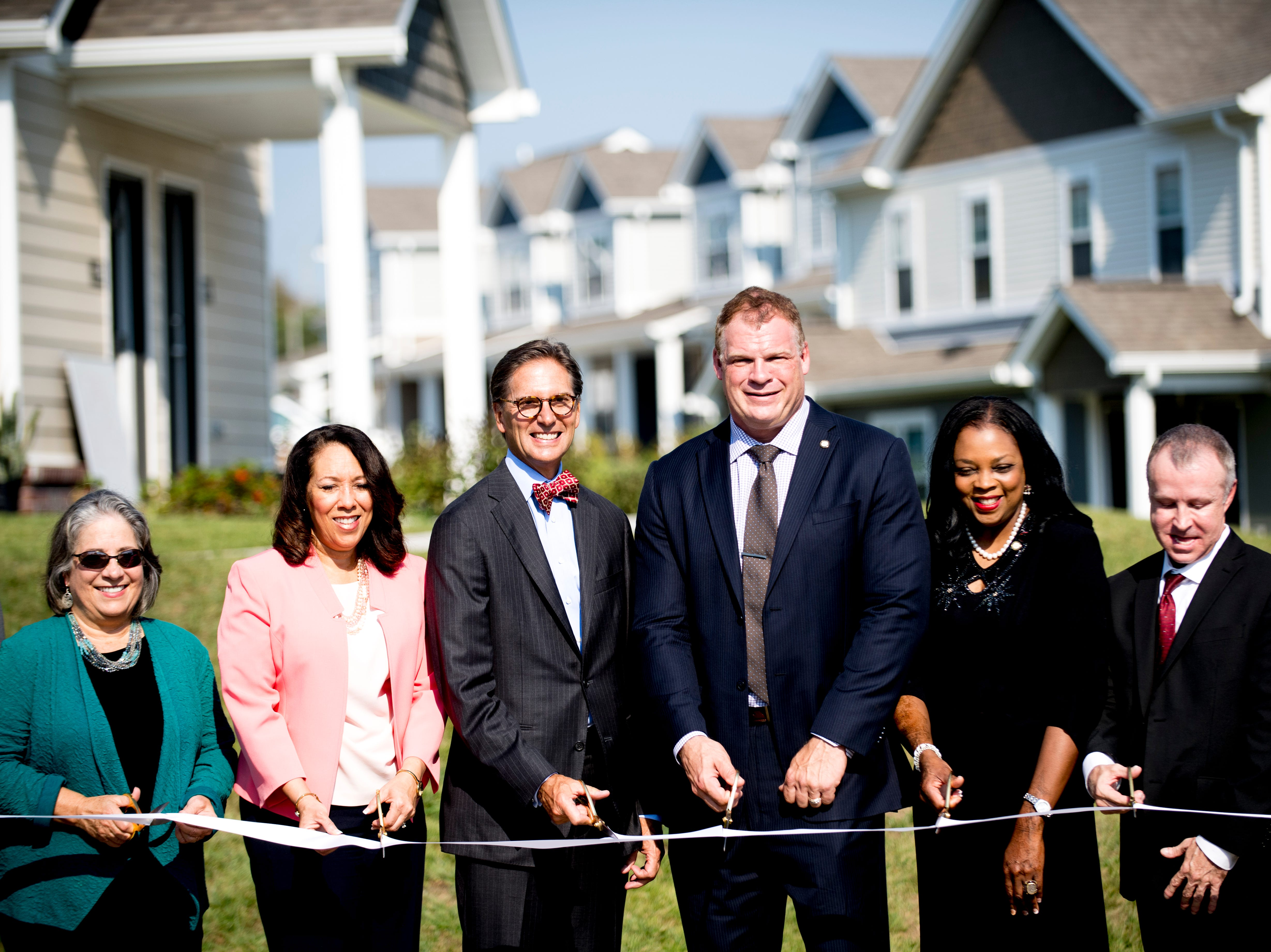 Officials pose for a photograph during the Five Points Phase 2 ribbon cutting ceremony in Knoxville, Tennessee on Wednesday, September 19, 2018. The 10-building, 84-unit affordable housing complex has been part of Mayor Rogero's focus on affordable housing.