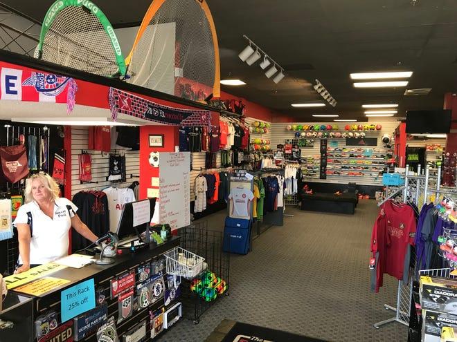 Soccer Post co-owner Kallin Rhodes minds the store on Sept. 19, 2018.