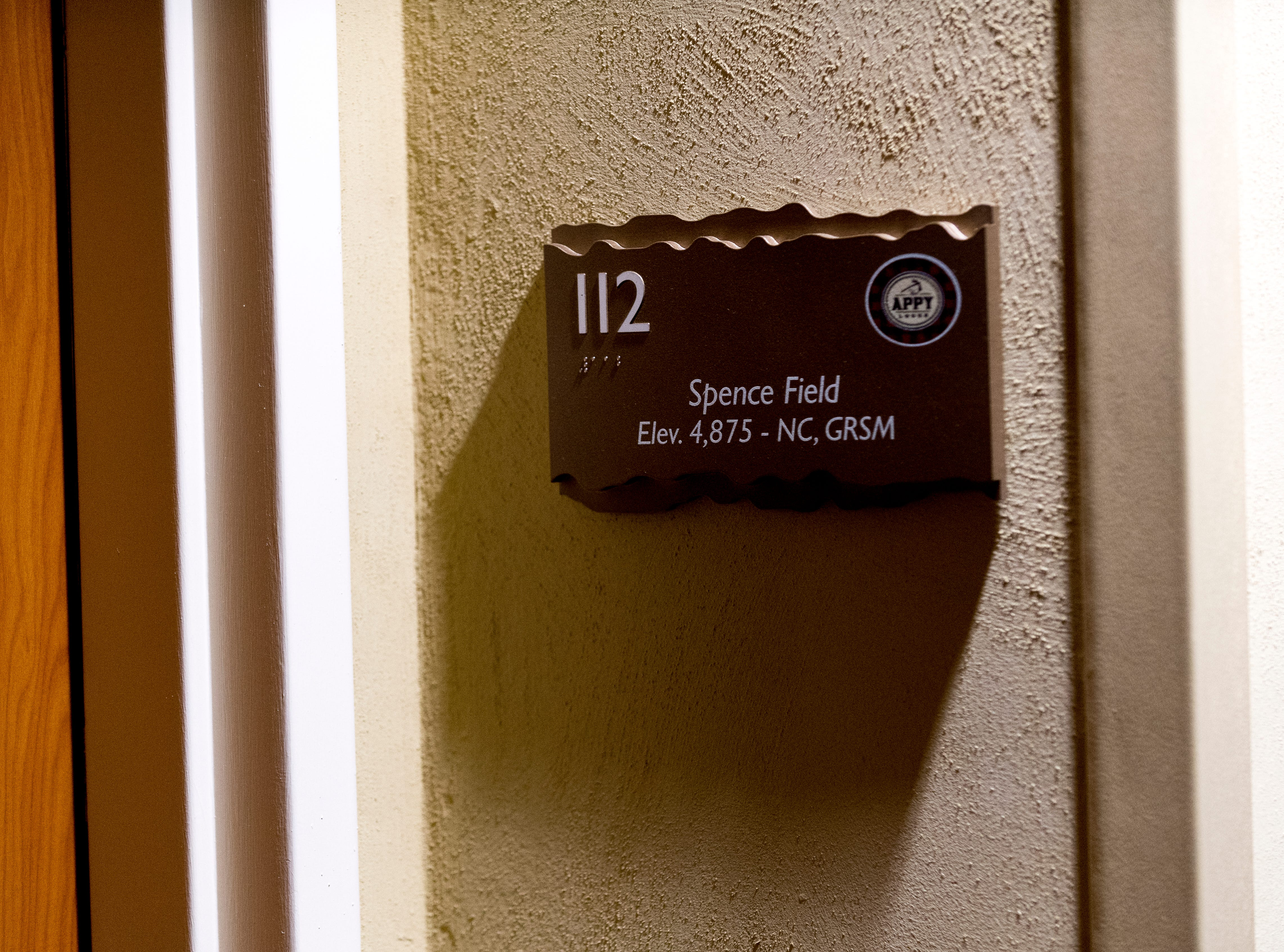 A room number sign in the hallway The Appy Lodge in Gatlinburg, Tennessee on Tuesday, September 18, 2018. The hotel partnered with Appalachian organizations to create a Appalachian Trail theme.