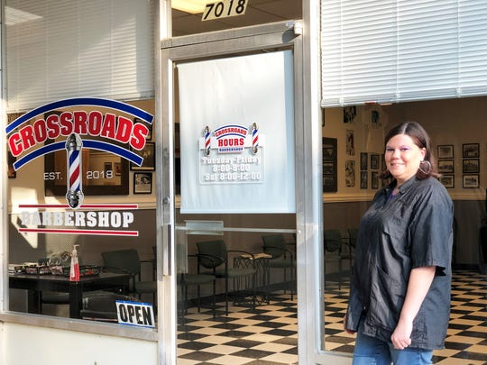 Kyla Monroe, in front of her Crossroads Barbershop in Halls. Monroe celebrated her own shop with a grand opening on Aug. 18.