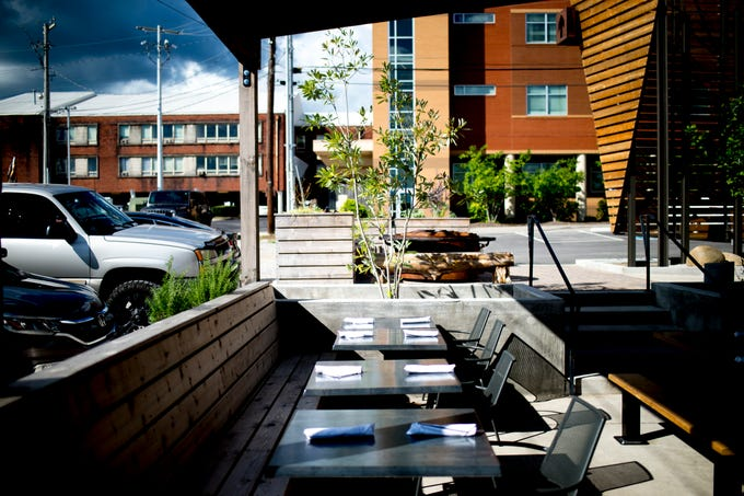 A view of the outdoor seating area at Elkmont Exchange in Knoxville, Tennessee on Friday, September 14, 2018. Elkmont Exchange features many fixtures and furniture inside the brewery and restaurant created by local makers.