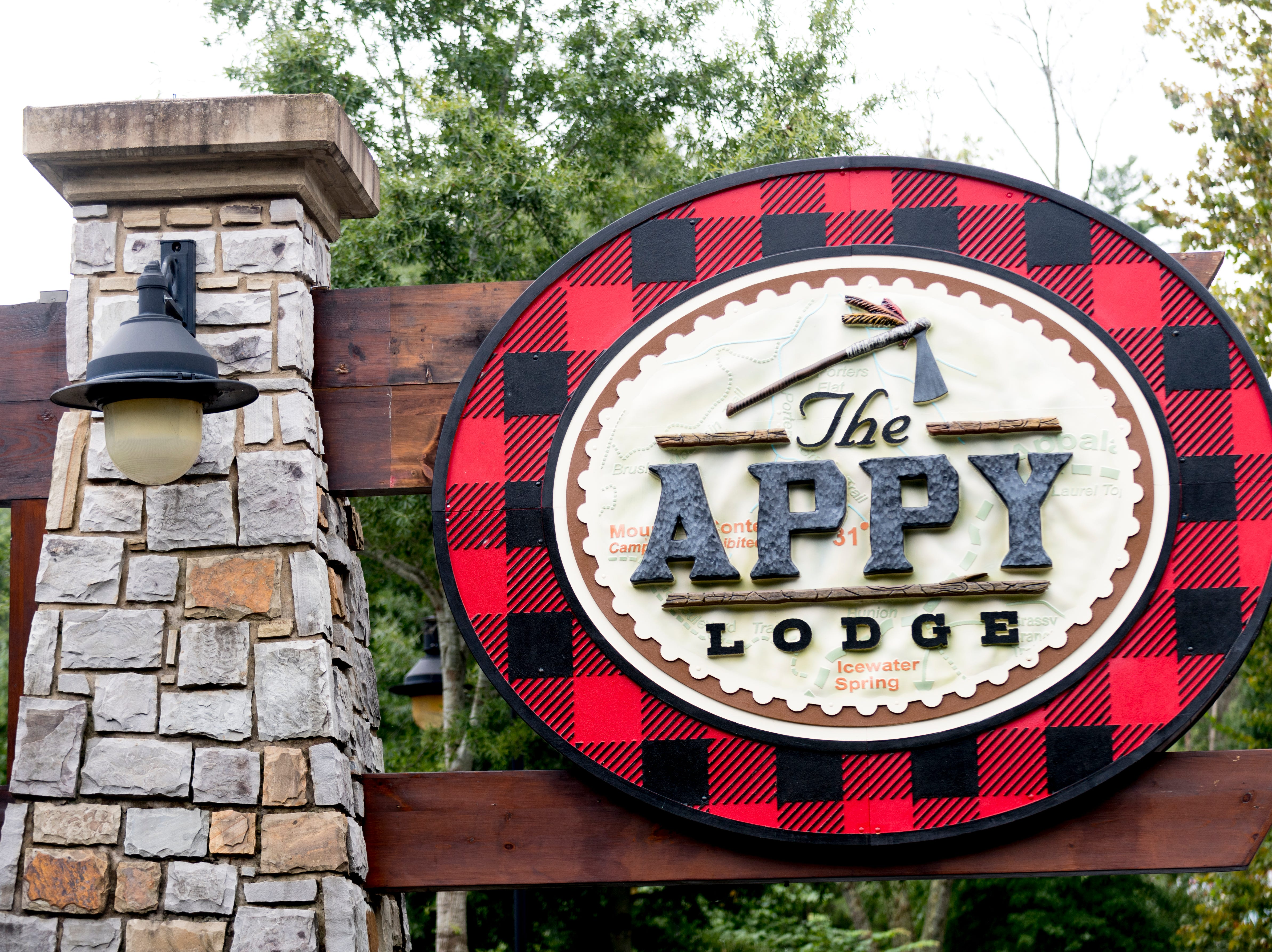 A large sign along the Parkway advertises The Appy Lodge in Gatlinburg, Tenn. The hotel partnered with Appalachian organizations to create an Appalachian Trail theme.