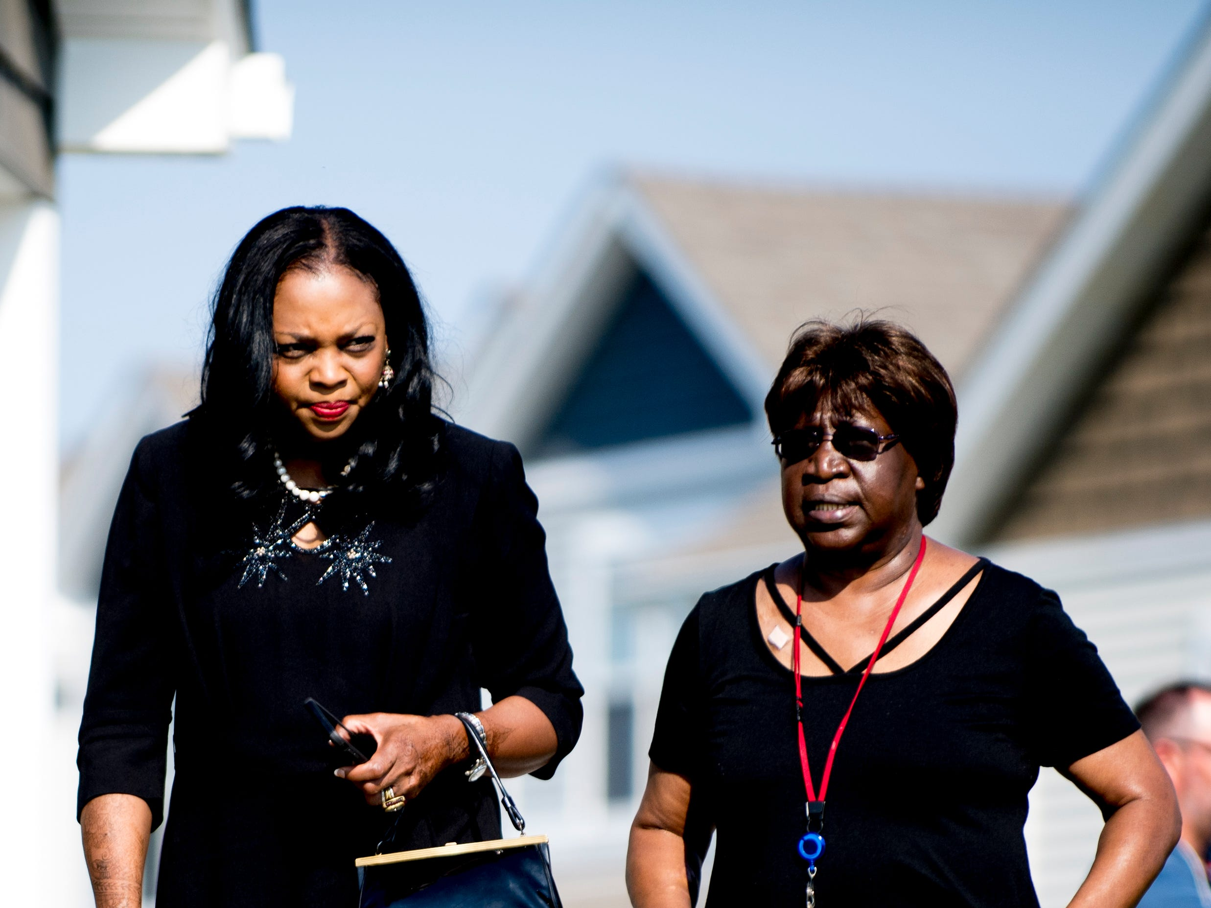 Knox County Commissioner Evelyn Gill and Gwen Winfrey, Community Development Senior Project Specialist, chat during the Five Points Phase 2 ribbon cutting ceremony in Knoxville, Tennessee on Wednesday, September 19, 2018. The 10-building, 84-unit affordable housing complex has been part of Mayor Rogero's focus on affordable housing.