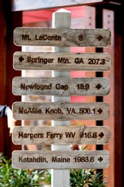 A sign outside the hotel lists distances of destinations at The Appy Lodge in Gatlinburg, Tenn. The hotel partnered with Appalachian organizations to create an Appalachian Trail theme.