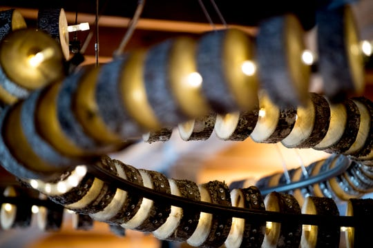 A lighting fixture was created locally at Elkmont Exchange in Knoxville, Tennessee on Friday, September 14, 2018. Elkmont Exchange features many fixtures and furniture inside the brewery and restaurant created by local makers.