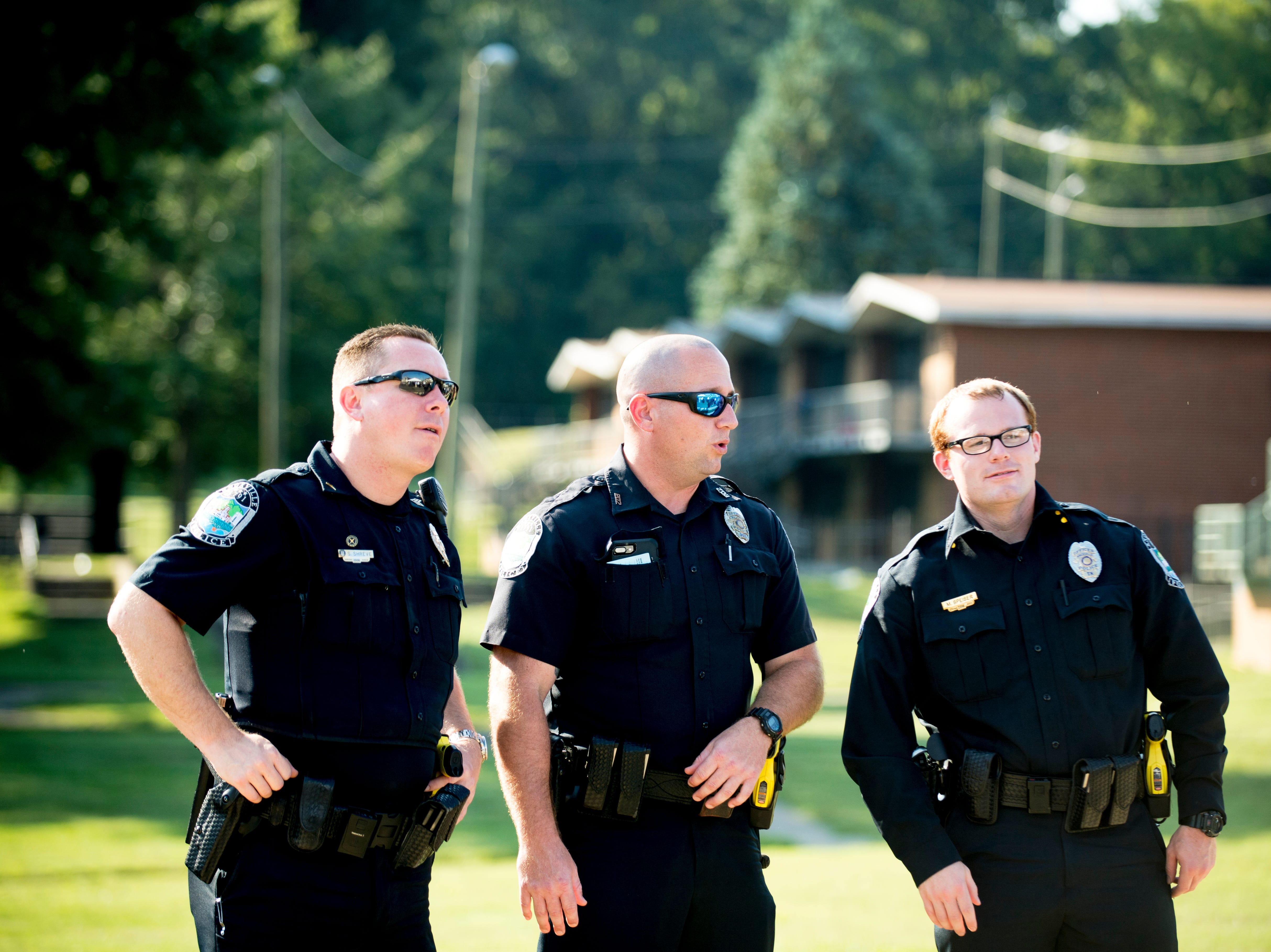 Knoxville Police Department officers chat during the Five Points Phase 2 ribbon cutting ceremony in Knoxville, Tennessee on Wednesday, September 19, 2018. The 10-building, 84-unit affordable housing complex has been part of Mayor Rogero's focus on affordable housing.