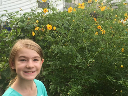 Leilani Johns, 9, poses at a backyard farm in Oak Ridge. She is running for alderman in Farragut.