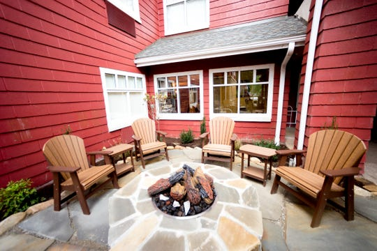A fire pit is outside The Appy Lodge in Gatlinburg, Tenn. The hotel partnered with Appalachian organizations to create an Appalachian Trail theme.