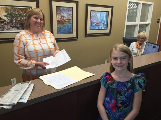Leilani Johns (right) poses for a photo while getting her application for alderman in Farragut approved Sept. 7, 2018. She is just 9 years old.