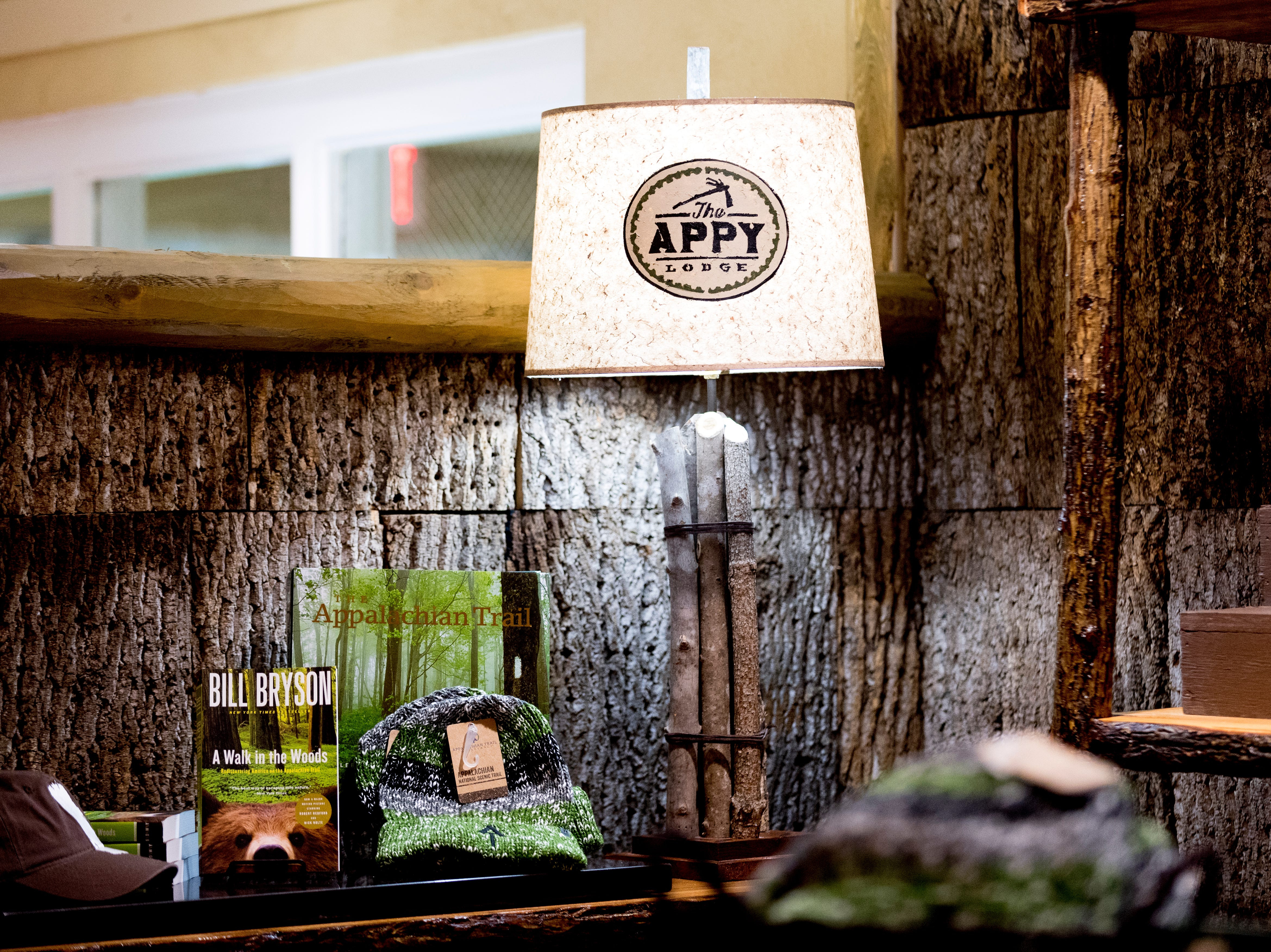 A lamp with the The Appy Lodge logo in the lobby at The Appy Lodge in Gatlinburg, Tennessee on Tuesday, September 18, 2018. The hotel partnered with Appalachian organizations to create a Appalachian Trail theme.