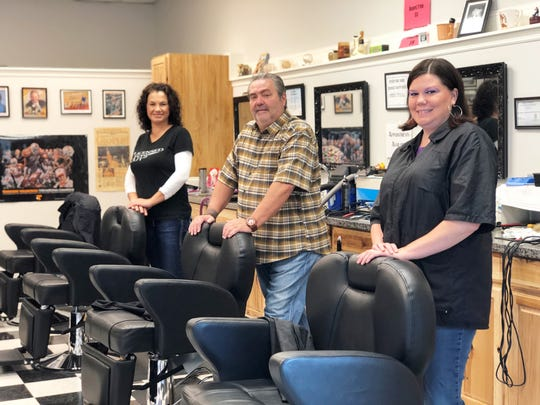 Crossroads Barbershop owner, Kyla Monroe (right) with Alma Katana and Mike Riggs in their new location in Halls Center on Maynardville Pike on Sept. 19, 2018.