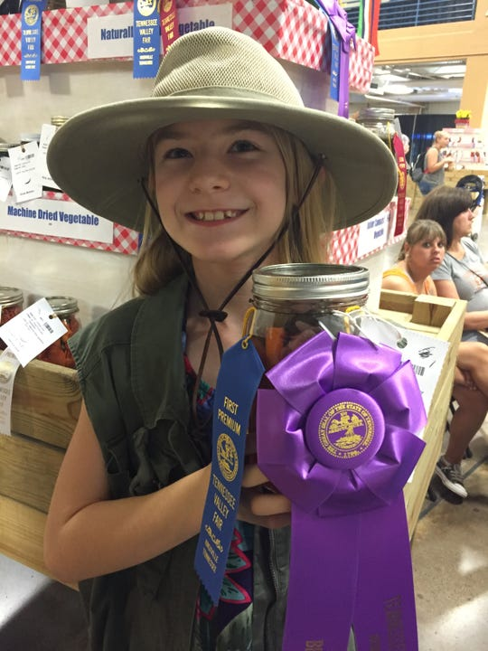 Leilani Johns, 9, poses with culinary and canning ribbons she won at the Tennessee Valley Fair. She is running for alderman in Farragut and would like to see gardens in the parks.