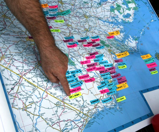 World Central Kitchen founder José Andrés points out some of their distribution points marked on a map of eastern North Carolina in their relief operation in Wilmington, N.C. on Sept. 19, 2018. Volunteers have prepared over 120,000 meals so far following Hurricane Florence.
