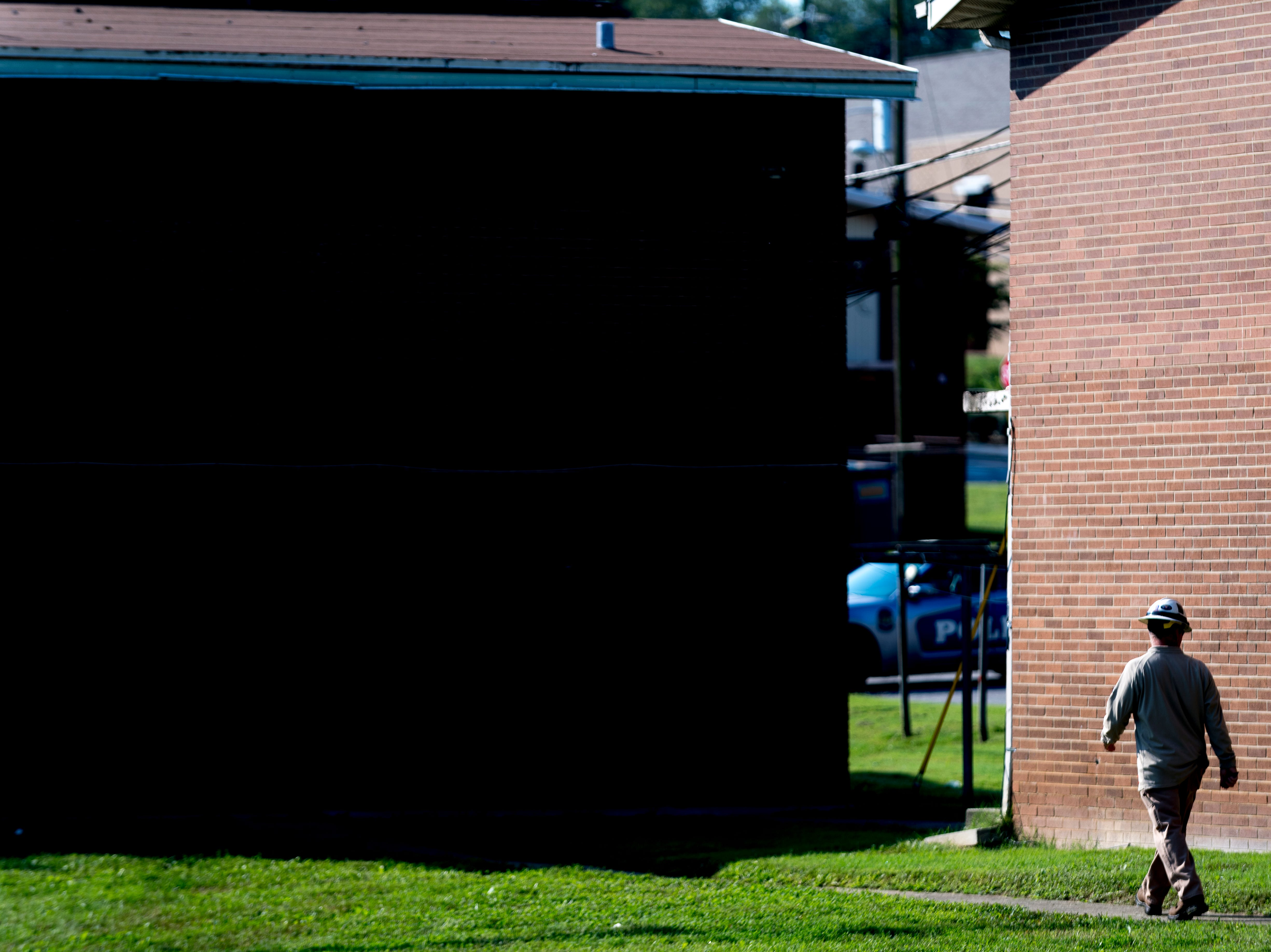 A man walks through Walter P. Taylor Homes in Knoxville, Tennessee on Wednesday, September 19, 2018. The 10-building, 84-unit affordable housing complex has been part of Mayor Rogero's focus on affordable housing.