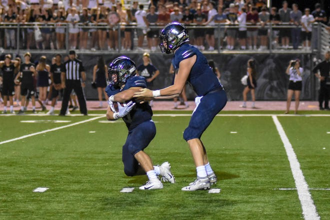 St. Thomas More quarterback Caleb Holstein and leading rusher William Cryer are two of many weapons for the vaunted Cougars' offense.