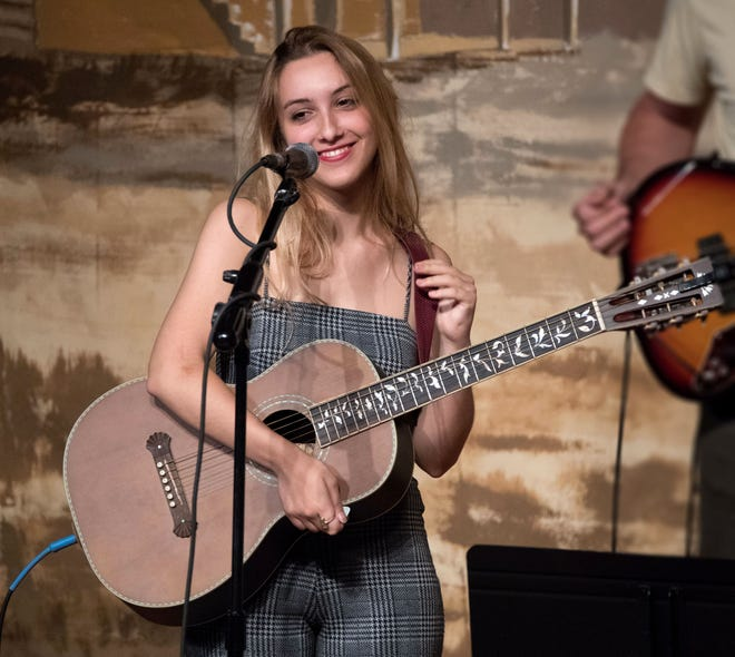 """Renée Reed, a traditional music major at UL Lafayette, performs with the Angelle Aces Friday at """"Boots, Bayous and Blues."""""""