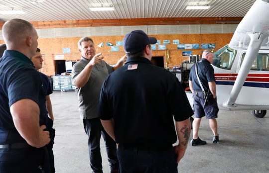 Mark Harden, program manager for the Federal Aviation Administration Safety Team, talks to Greenfield Township firefighters about the hazards of attempting rescues from an airplane Wednesday, Sept. 19, 2018, at the Fairfield County Airport in Lancaster.