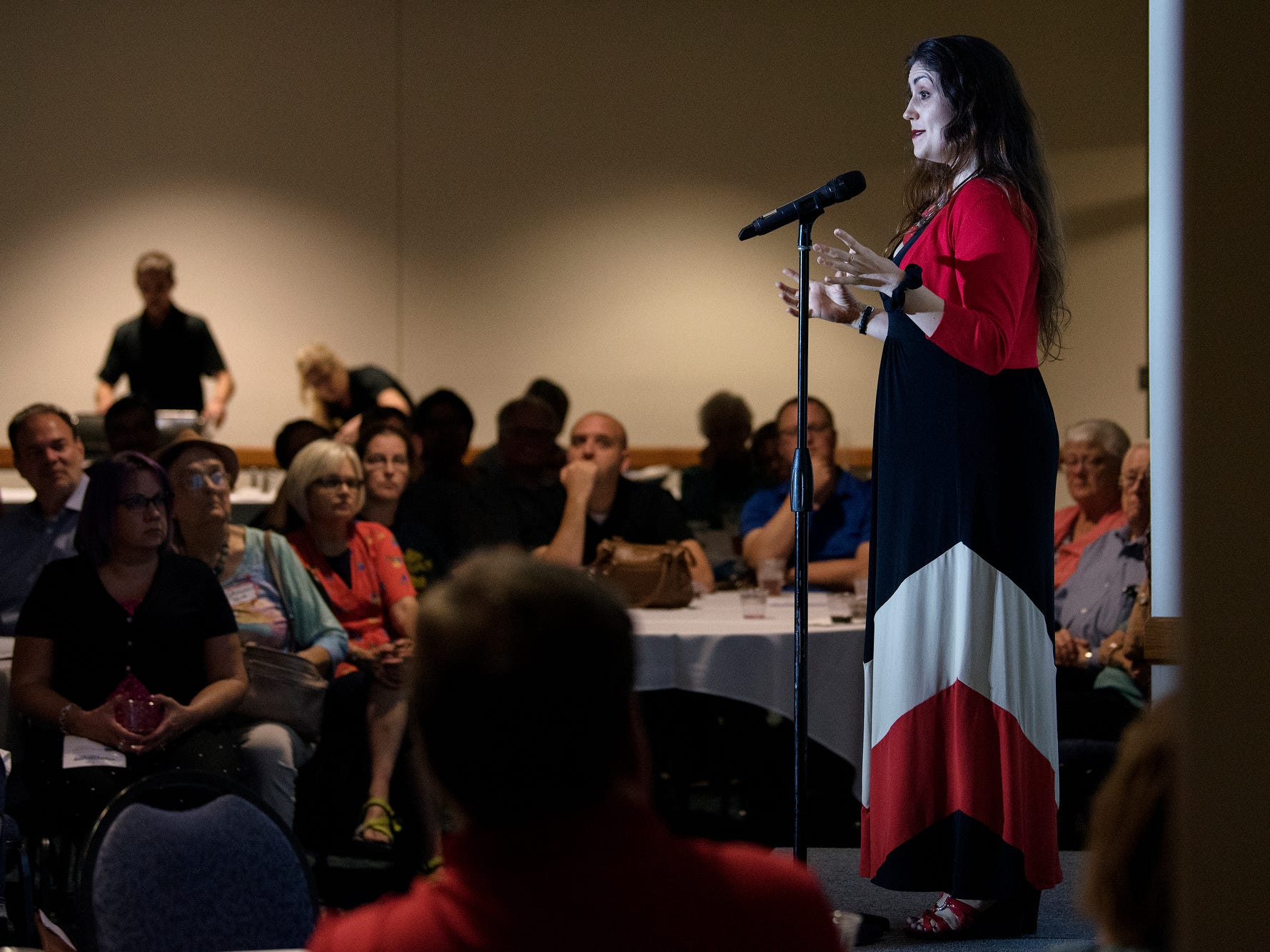 Lesley Keith speaks during the Lansing Storytellers Project: 'Are We There Yet?' event on Tuesday, Sept. 18, 2018, at the Hannah Community Center in East Lansing.