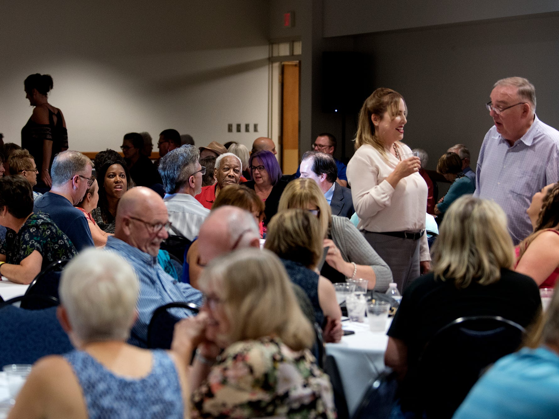 Members of the crowd mingle during the Lansing Storytellers Project: 'Are We There Yet?' event on Tuesday, Sept. 18, 2018, at the Hannah Community Center in East Lansing.