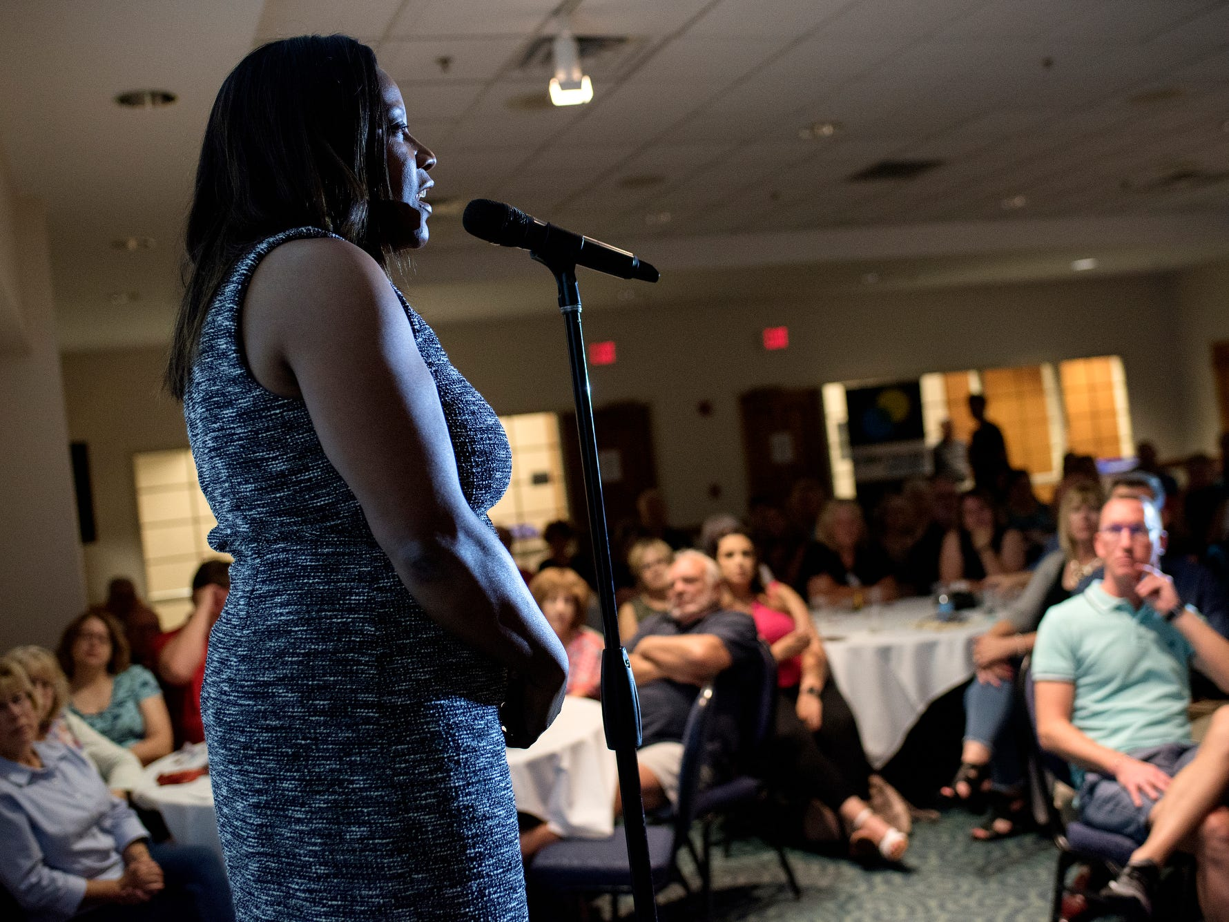 Angela Hall speaks during the Lansing Storytellers Project: 'Are We There Yet?' event on Tuesday, Sept. 18, 2018, at the Hannah Community Center in East Lansing.
