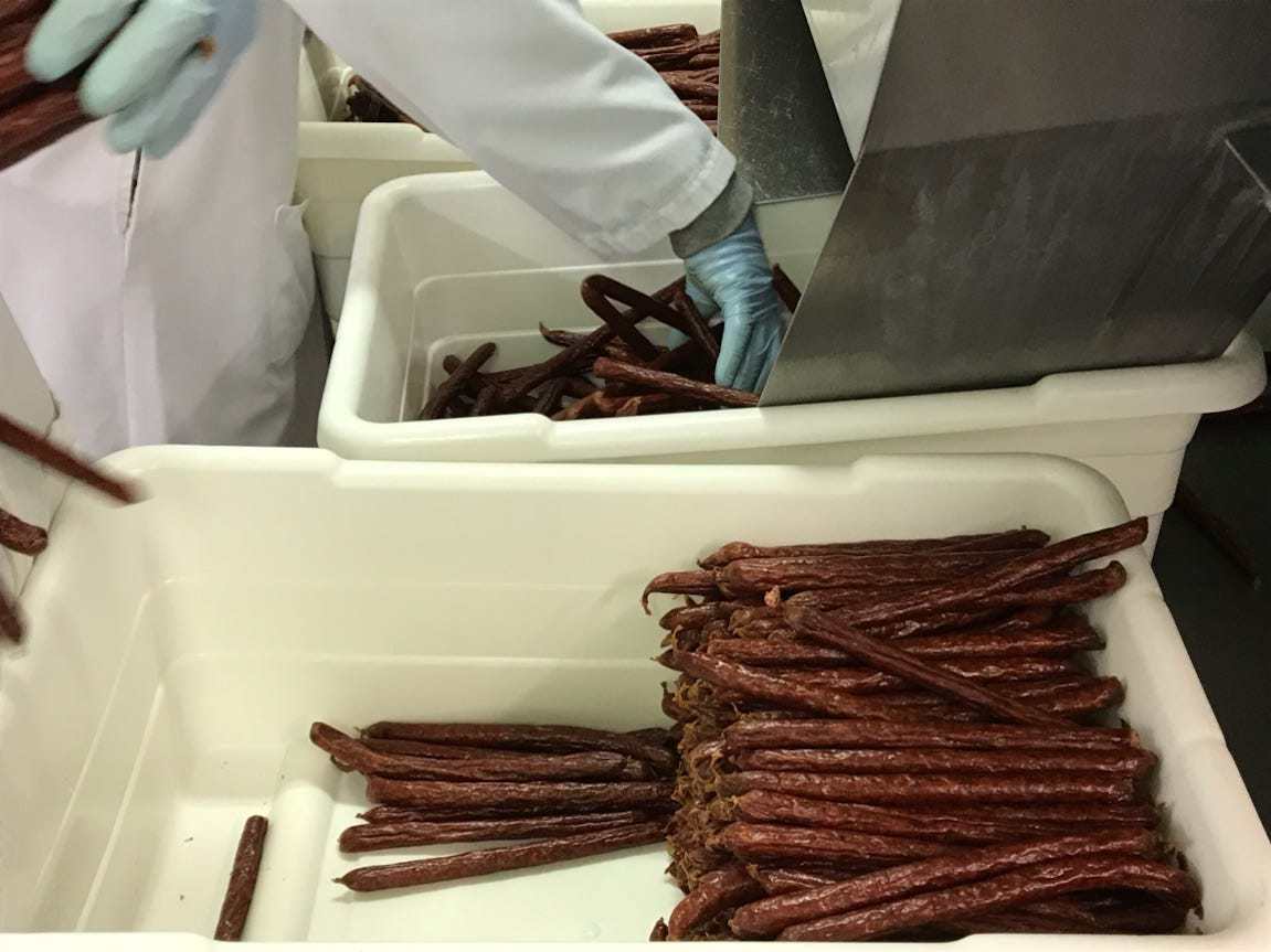 Wenzel's Farm snack sticks coming out of machines at Wenzel's Farm plant in Marshfield.