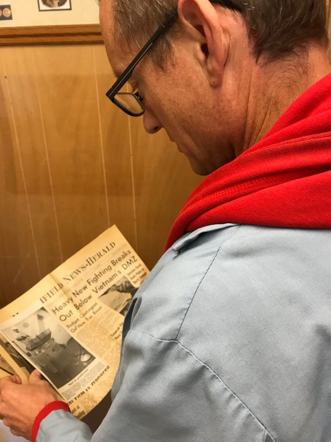 Wenzel's Farm president Mark Vieth looks at an old newspaper clipping about Wenzel's Farm.