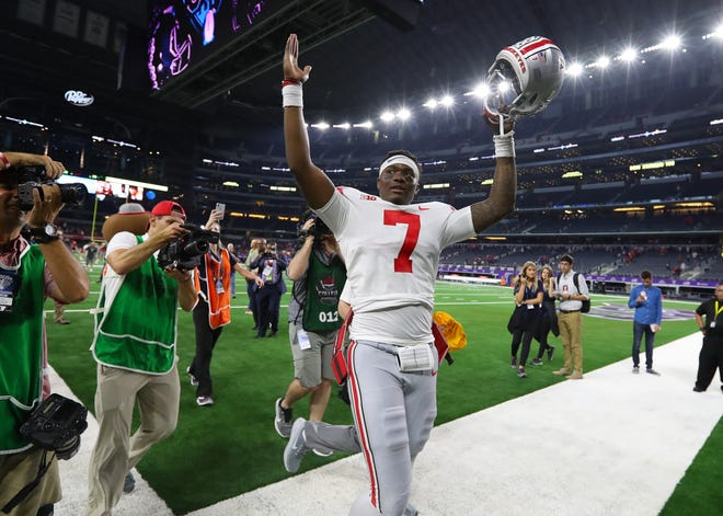 Ohio State quarterback Dwayne Haskins celebrates after the 40-28 comeback victory over TCU.