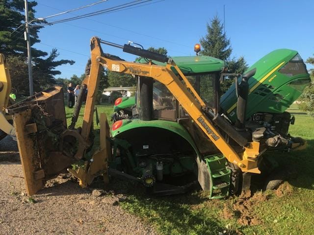 This tractor pinned Mike Switzer Tuesday on Reed Road. Employees of Strauser Construction stopped to call 911 and help the Mifflin Township road superintendent after a wheel flew off the tractor and he was ejected and pinned below the machine.