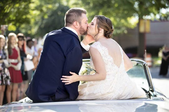 Joel and Lindsey Alsup left their wedding in the pavilion on the St. Jude campus in a 1959 Ford Fairlane convertible.
