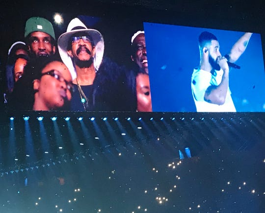 Rapper and singer Drake shouts out his dad, Dennis Graham, and family in attendance at his Nashville concert at Bridgestone Arena on September 18, 2018.