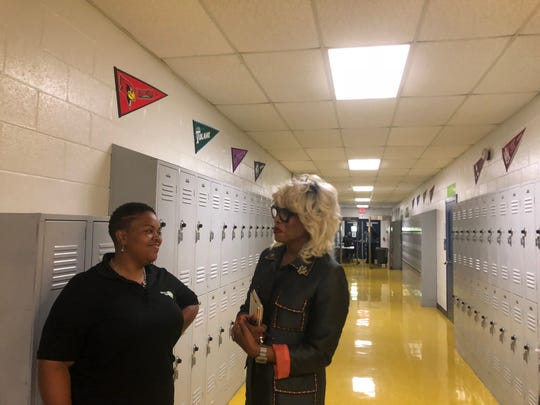 Kirby Middle Principal Marian Williams and Achievement School District Superintendent Sharon Griffin tour the school on Wednesday. The school is allowing Shelby County Schools to use space for Kirby High School students who were displaced after rats invaded their building.