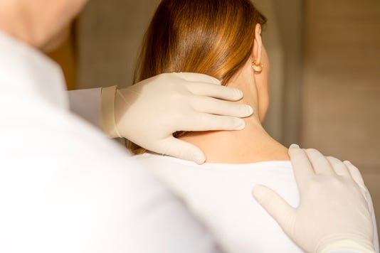 Chiropractor Doing Adjustment On Female Patient Due To Neck Pain