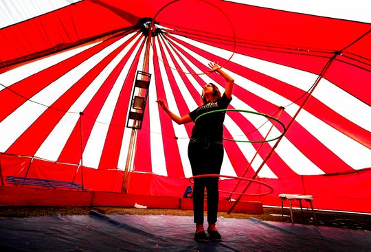 "Circus performer Leslie Luna practices her hula hoop act under families ""Big Top"" tent while preparing for the upcoming The Mid-South Fair at the Landers Center in Southaven, Miss. The fair, which features carnival rides and food will run for 10-days starting Wednesday."