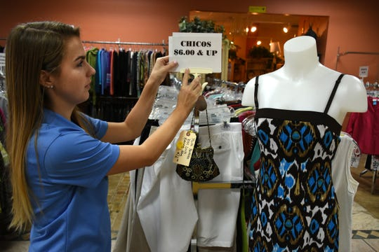 Store manager Samantha ÒSamÓ Kopren shows off the dedicated Chico's section. The Bargain Basket, a mission of United Church of Marco Island, has paid off all indebtedness on the property through their sales of used clothes and home goods.