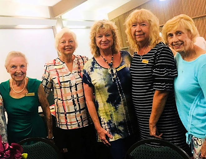 Members Margaret Moores, Eve Connolly, Cindy Crane, Bobbie Ordija, and Madeline Moore enjoy the luncheon.