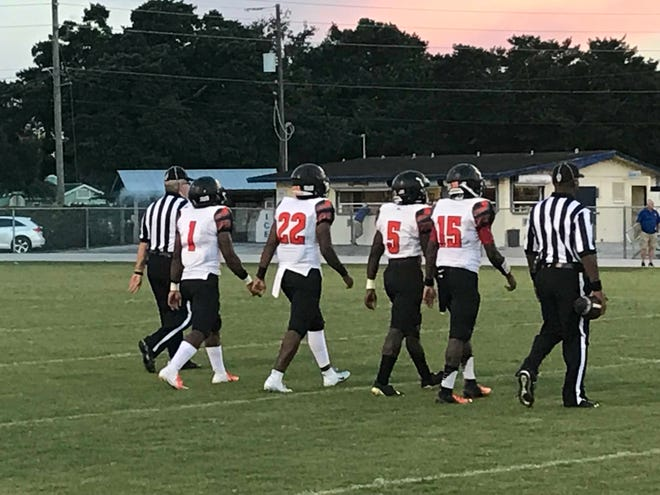 From left, Lely football players Matt Desir, Jayden Noel, Henderson Francois and Jonis Dieudonne head out to midfield for the coin toss prior to a game against Clewiston on Friday, Sept. 14.