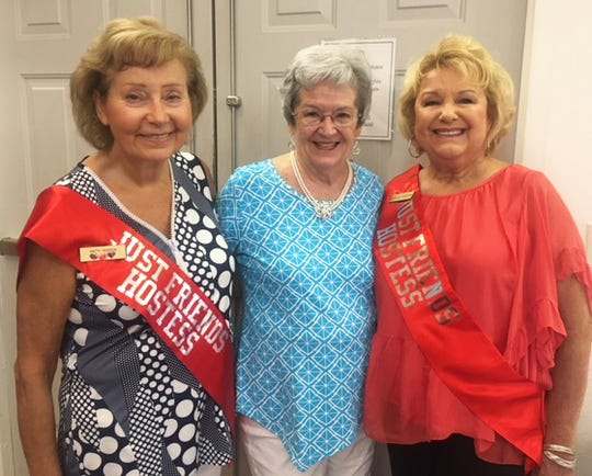 Hospitality co-chair Patty Terreri greets member Barbara Markel with Hospitality co-chair, Ruth Lee DeVaughn.