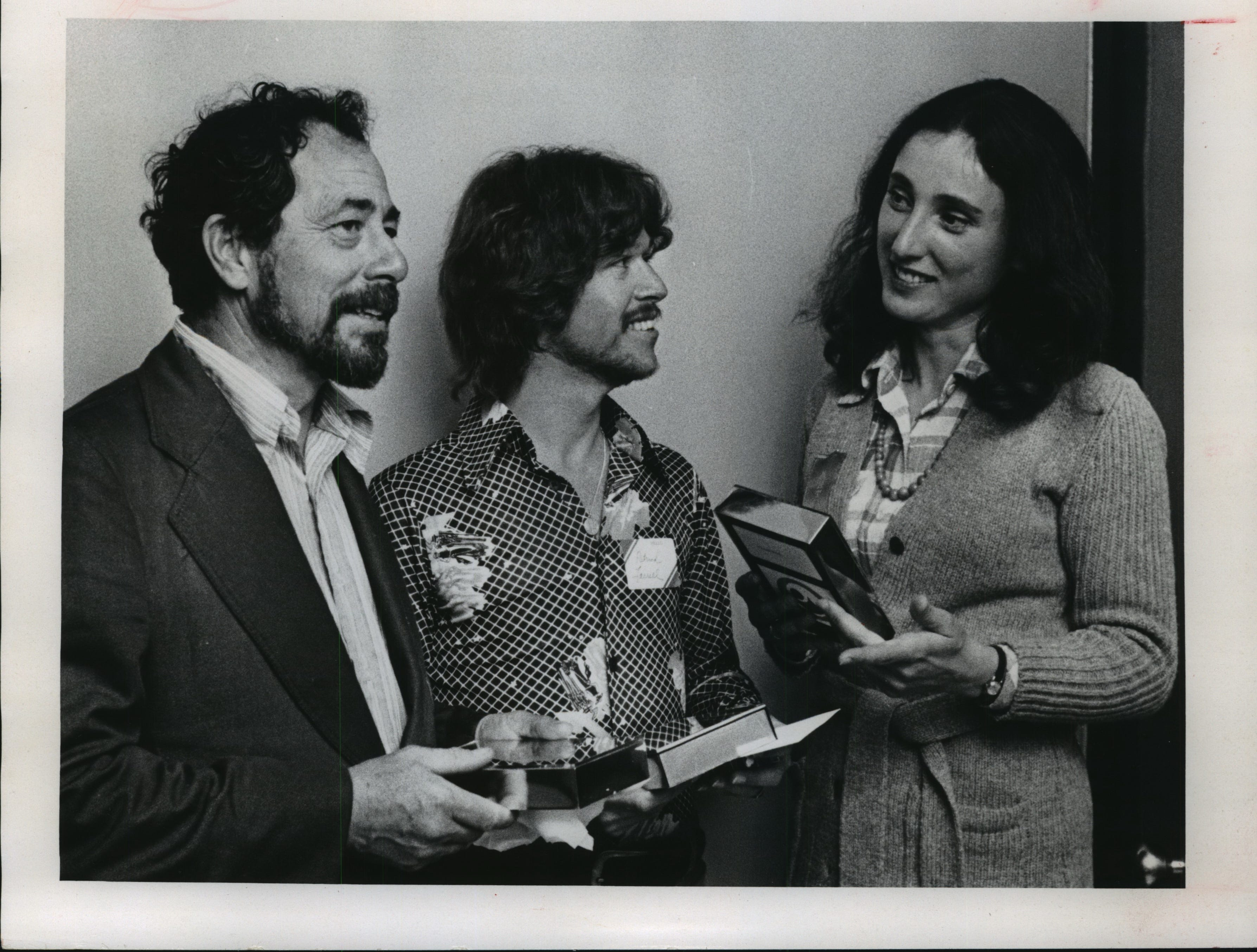 1974: The husband-and-wife team of Warrington Colescott (left) and Frances Myers, Madison, received two of the 10 cash awards given at the artists' award dinner at the Milwaukee Art Center. They were congratulated by Milwaukee artist Patrick Farrell (center), whose oil painting was selected as the 1974 Lakefront Festival of Arts purchase award.
